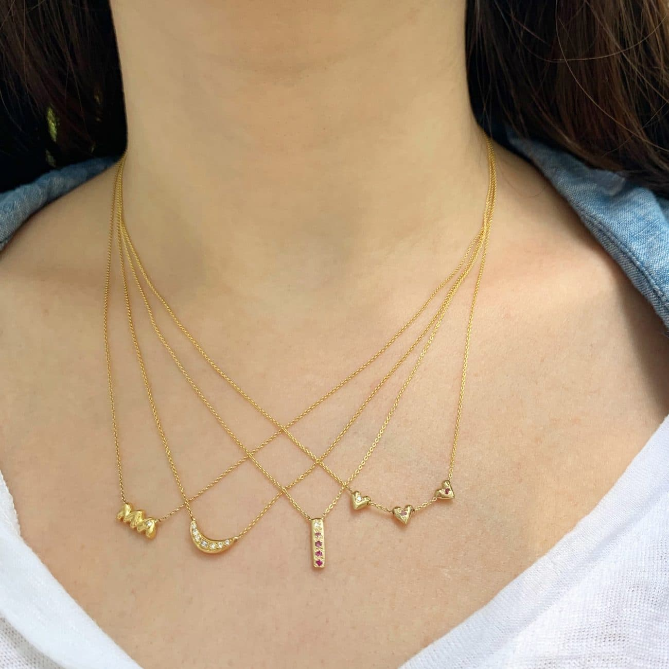 wearing the teeny tiny heart necklace and skinny bar necklace