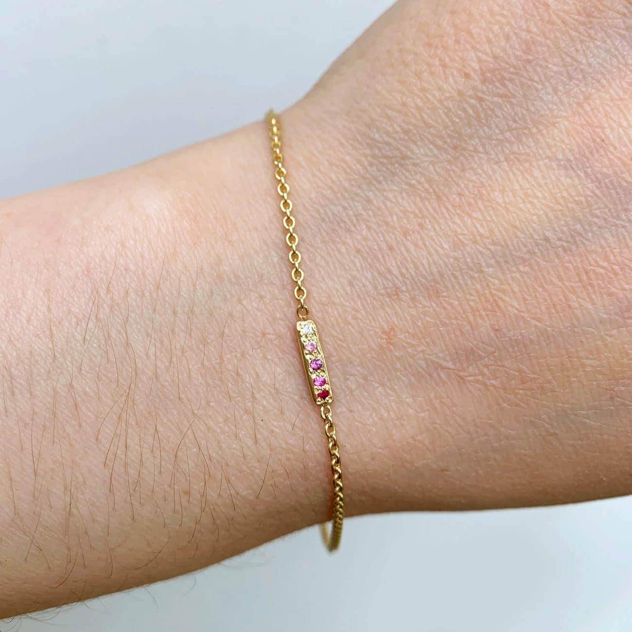 wearing the skinny bar bracelet in 14k yellow gold