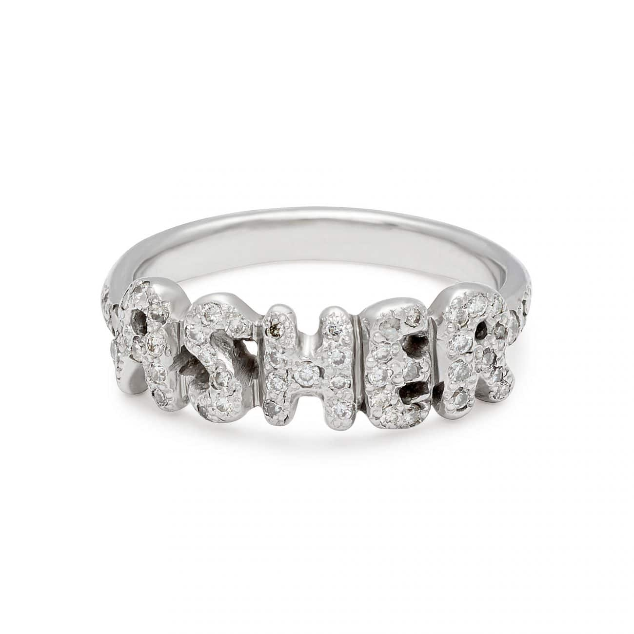platinum name ring with white diamonds